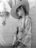 Lilyan Tashman Leaning on Dress with Hat