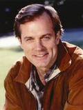 Stephen Collins smiling in Brown Leather Jacket
