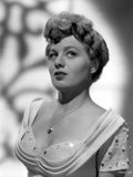 Shelley Winters wearing a White Dress in a Classic Portrait