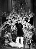 Mary Martin standing in Front of Christmas Tree