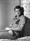 Rock Hudson sitting on Floor With Two Arm's Cross