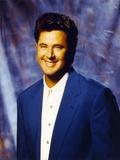 Vince Gill smiling in Blue Coat