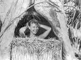 South Pacific Women Taking a Bath in Bathroom Nipa Hut