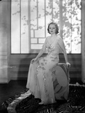 Talullah Bankhead sitting in Embroidered Dress