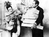 Rosalind Russell in Fur Coat with Man Carrying Presents