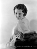 Sylvia Sidney Leaning in a Long Sleeve Dress