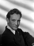 Trevor Howard Posed in Black Suit With White Background