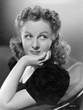 Susan Hayward sitting and Face Leaning on Hand on Chair in Black Dress