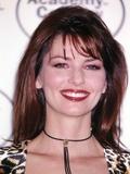 Shania Twain smiling in Animal Print Dress