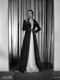 Sylvia Sidney wearing and Smoking in Gown