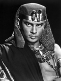 Yul Brynner Posed in Egyptian Attire With Black Background