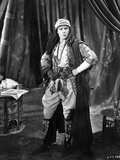Rudolph Valentino standing with Hand on Hips