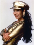 Selena in Gold Suit and Cap