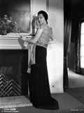Sylvia Sidney Leaning on a Fireplace in Black Long Skirt