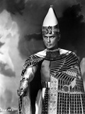 Yul Brynner standing in Egyptian Attire With Gold