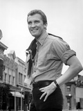 Roy Thinnes standing in Formal Shirt With Hands on Hip