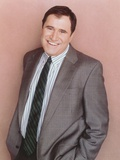 Spin City Cast Member smiling in a Portrait wearing Formal Suit