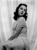 Susan Hayward wearing an Embroidered Gown