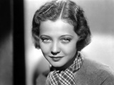 Sylvia Sidney in Printed Scarf and Textured Blouse