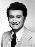 Regis Philbin smiling in Black and White Close Up Portrait wearing Formal Coat