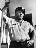 Rod Steiger standing in Police Attire