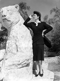 Rosalind Russell Leaning on Bear Statue