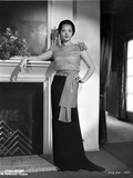 Sylvia Sidney posed Beside the Fireplace and Hand on Waist