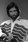 Richard Chamberlain Posed in Swordsman Attire With Sword