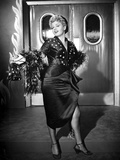 Shelley Winters Posed in Black Dress with Sarong Skirt and Fur Boa