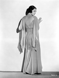 Sylvia Sidney Leaning on a White Wall in Gown
