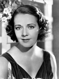 Ruby Keeler on a Dark Top and posed