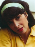 Talia Shire wearing a Yellow Polo with White Headband