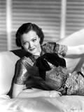 Sylvia Sidney in a Black Dress and Hand on Waist with Hat