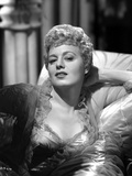 Shelley Winters on the Bed in Ruffled Lace Dress