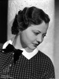 Sylvia Sidney wearing a Printed Blouse with Ribbon