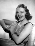 Ruby Keeler sitting and Hands on Prayer Pose