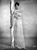Suzanne Pleshette wearing a Silk Gown and Leaning on Post