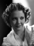 Sylvia Sidney wearing a Ruffled White Blouse