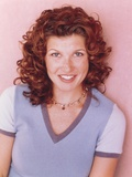 Spin City Cast Member smiling in a Portrait wearing Casual Dress