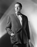 Orson Welles standing in Hand on Pocket