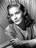 Vera Miles pictured in portrait with arms crossed  weraing a quartered sleeved blazer