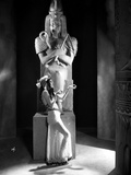 Zita Johann Leaning on Statue  wearing Sexy Dress