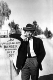 Yul Brynner Leaning in Sign Board With Hat