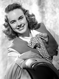Terry Moore Seated and Leaning in Classic