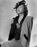 Portrait of Gloria Swanson in Formal Outfit