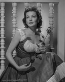 Gene Tierney Holding Flower in Dress