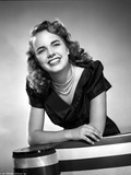 Terry Moore Leaning and smiling Portrait in Classic