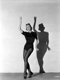 Vera Zorina wearing black leotard  black stockings  and side-clasped dance shoes  with one arm rais