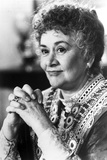 Joan Plowright wearing a Well Detailed Dress  Clasping Hands in a Classic Portrait