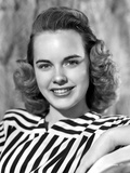 Terry Moore on a Stripe Top and smiling